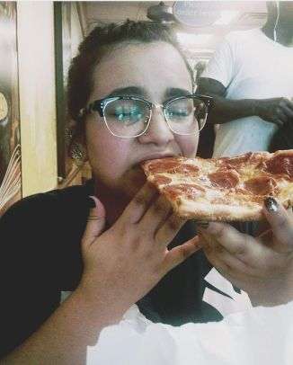Gnawing on my first NYC PIZZA